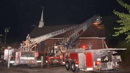 Firefighters at the scene of a church fire
