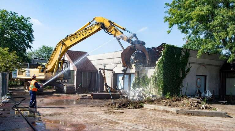 Crews work on the Village Square demolition in