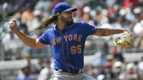 Robert Gsellman of the Mets pitches against the