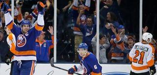 Islanders center John Tavares, far left, celebrates after