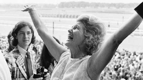Penny Chenery, owner of Secretariat, celebrates after her