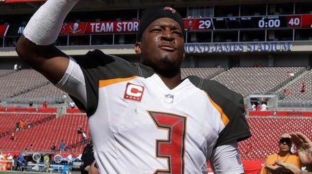 Buccaneers quarterback Jameis Winston raises his fist as