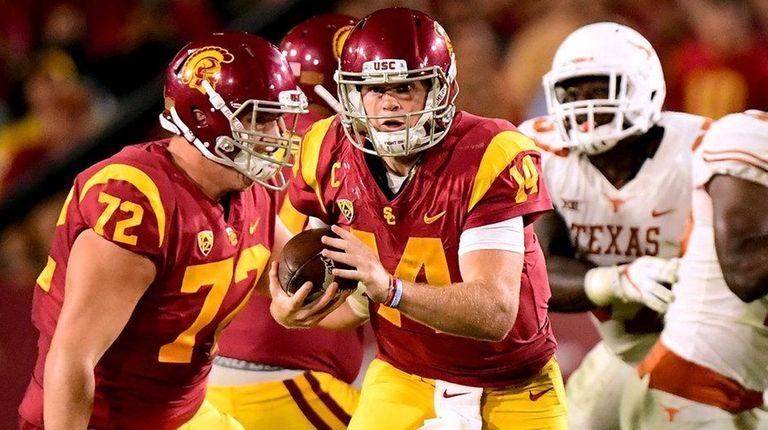 Sam Darnold of the USC Trojans scrambles away