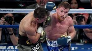 Canelo Alvarez throws a punch at Gennady Golovkin