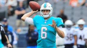 Jay Cutler of the Dolphins throws a pass