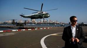 Marine One, carrying President Donald Trump, lands at