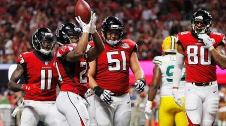 Devonta Freeman of the Falcons celebrates after scoring