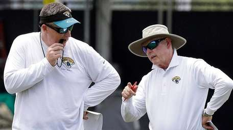 Jacksonville Jaguars head coach Doug Marrone, left, talks
