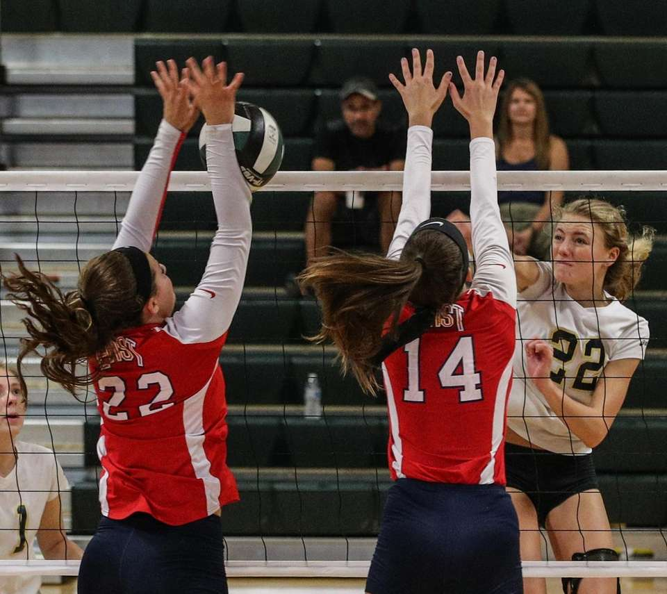 Smithtown East's Kate Cosgrove (22) blocks Emma Florentine