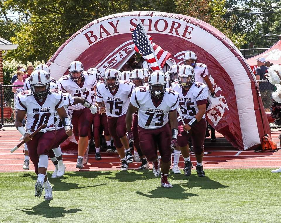 The Bay Shore Marauders enter the field to