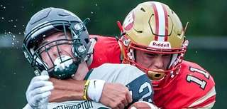 Westhampton's Dylan Laube gets hit by Half Hollow