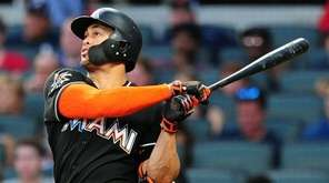 Giancarlo Stanton #27 of the Miami Marlins hits