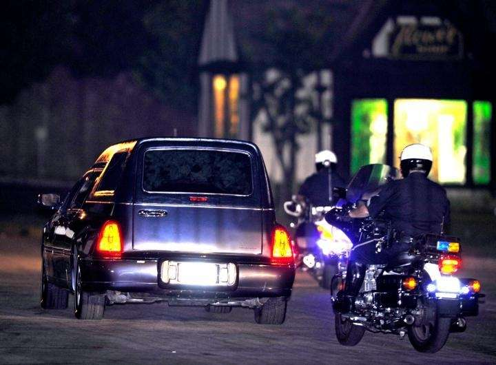 The hearse carrying Michael Jackson's body drives up
