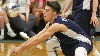 Northport's Ben Sandt plays the ball during a