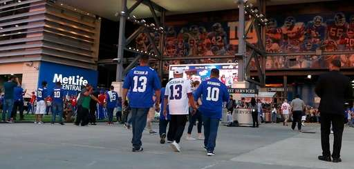 Fans arrive for a game between the New