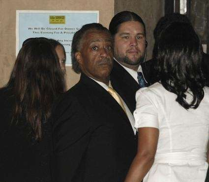 The Rev. Al Sharpton arrives at the funeral