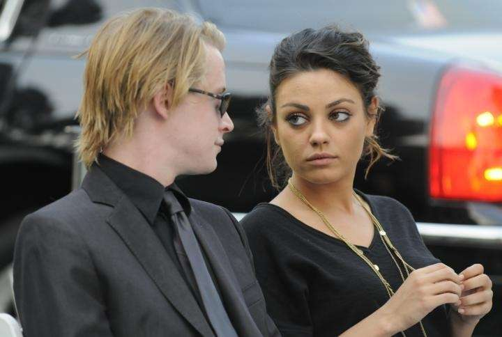 Actor Macaulay Culkin and actress Mila Kunis attend
