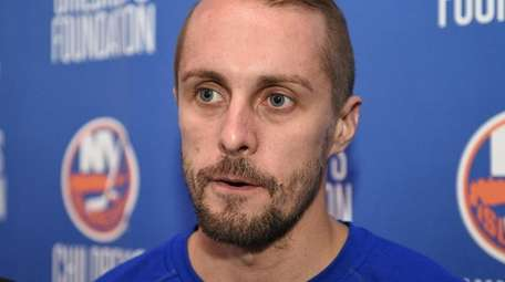 Islanders goalie Jaroslav Halak speaks to the media