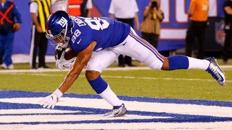 Evan Engram of the New York Giants hauls