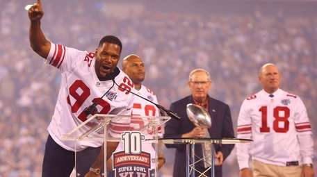 2007 Super Bowl champion Michael Strahan acknowledges the crowd