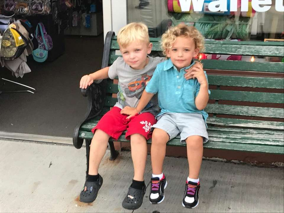 Lincoln Allen and Jase Matthew sitting outside a