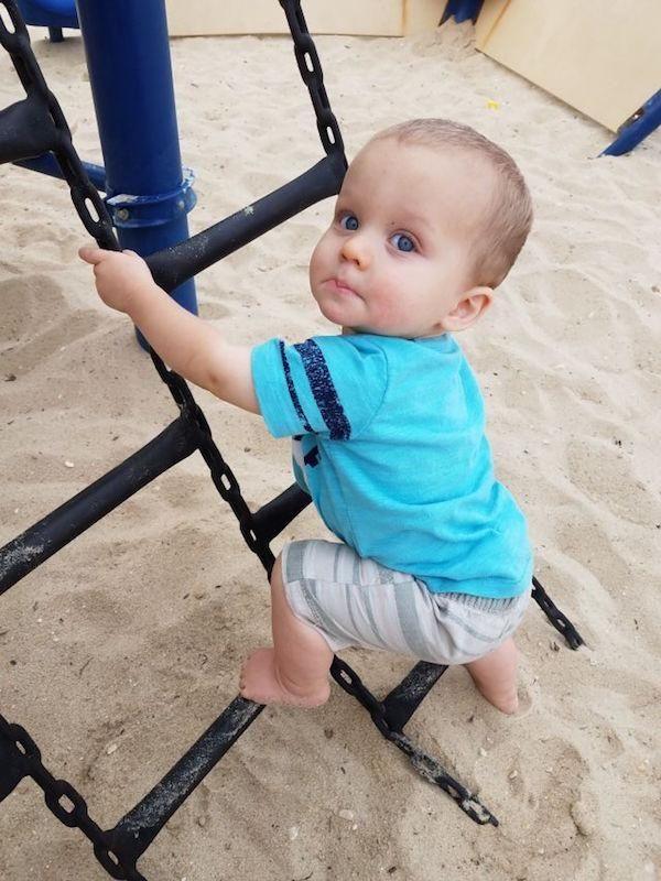 Grandson learning the joys of a summer park