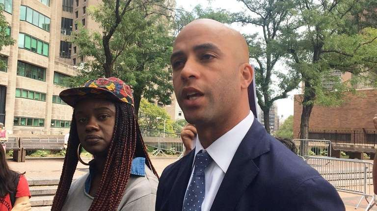 Former tennis star James Blake outside police headquarters