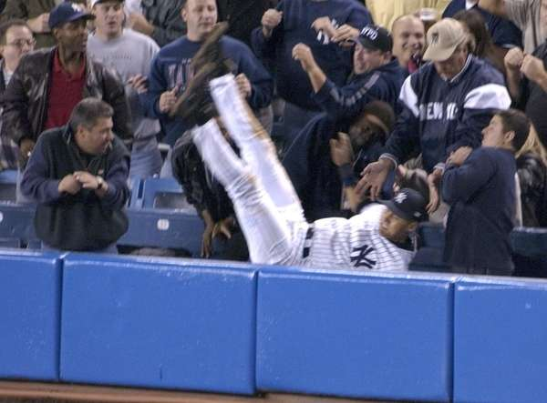 Yankees shortstop Derek Jeter catches a foul ball