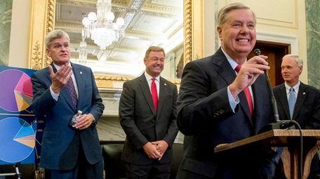 From left, Sen. Bill Cassidy (R-La.), Sen. Dean