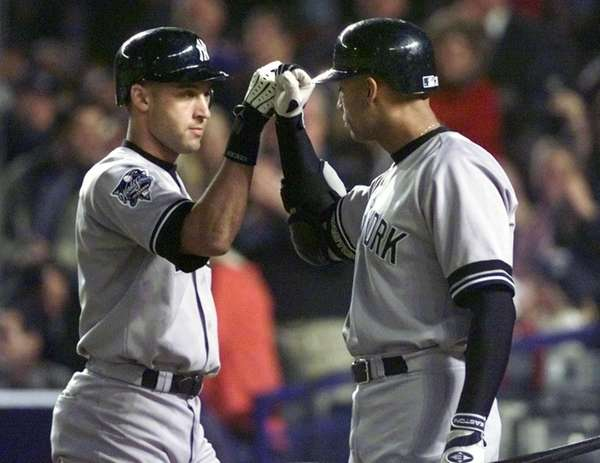 Derek Jeter, left, is congratulated by teammate David