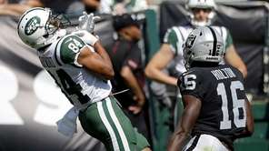 TheJets' Kalif Raymond, left, fumbles a punt in