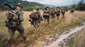 Soldiers on patrol during the Vietnam War. Documentarian