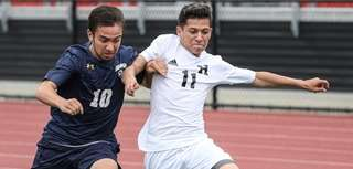 Massapequa's Brian Taglialavore battles for ball control with