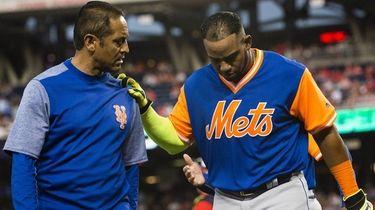 Yoenis Cespedes of the Mets is helped off
