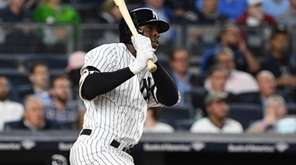 Yankees shortstop Didi Gregorius doubles against the Twins