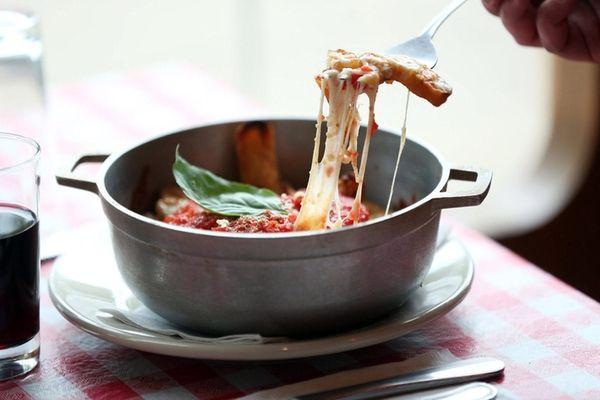 Top steak fries with tomato sauce and mozzarella,