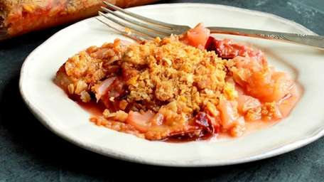 Apples and Italian plums tossed with maple syrup
