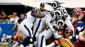 The Los Angeles Rams defense makes a tackle