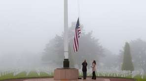 U.S. staff members raise the U.S. flag at