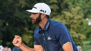 Dustin Johnson reacts after he birdies the playoff