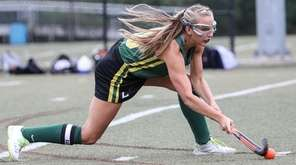 Shannon Coughlan of Ward Melville goes low to
