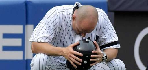 Yankees third base coach Joe Espada reacts after