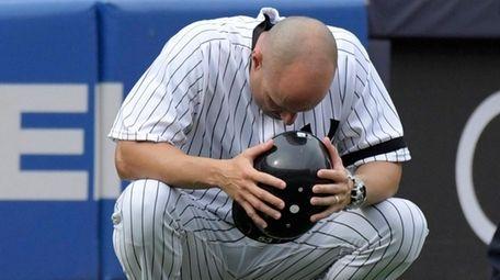 Yankees third base coach Joe Espada reacts after