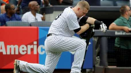 Todd Frazier of the Yankees reacts after a