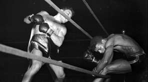 Jake La Motta, left, knocks Sugar Ray Robinson