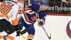 Islanders left wing Anthony Beauvillier shoots the puck
