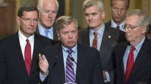 Sen. Lindsey Graham, R-S.C., joined by, from left,