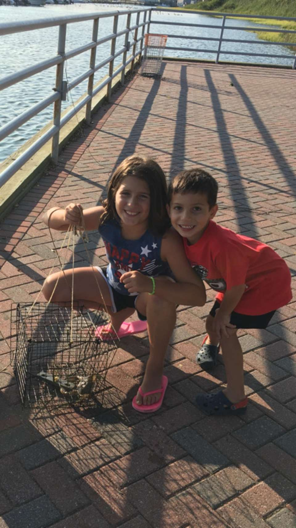 Sophia Masone and brother Michael Masone crabbing and