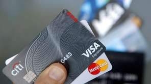 Credit cards are seen in Haverhill, Mass., June