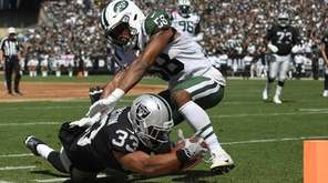 DeAndre Washington of the Oakland Raiders gets tackled